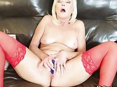 Sizzling blonde dressed in red latex wanking her honeypot fuckhole all alone